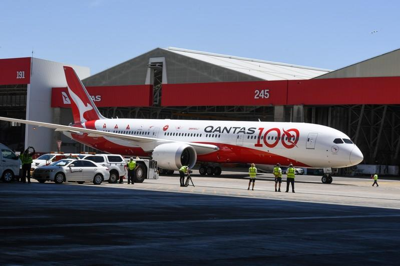 Qantas flight QF7879, which flew direct from London to Sydney, arrives at the hangar for the Qantas Centenary Launch at Qantas Sydney Jet Base in Sydney