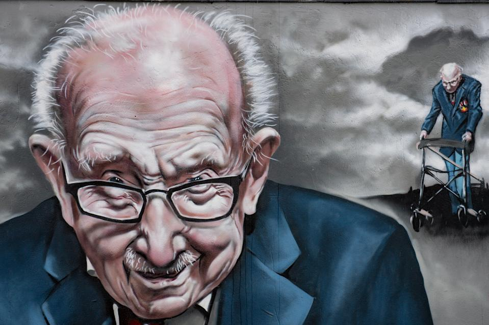 Detail of a mural that has been created to pay tribute to NHS fundraiser Captain Tom Moore outside Bradley Scott Windows in Tamworth, Staffordshire.