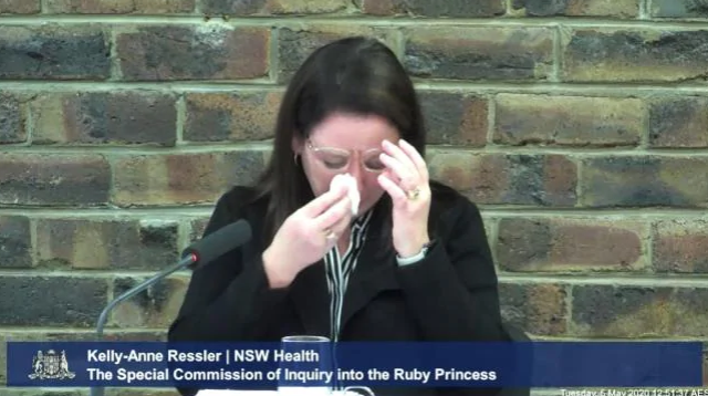 "Ms Ressler is seen crying after Commissioner Bret Walker SC suggested there'd been a ""reprehensible shortcoming"" by the department. Source: ABC"