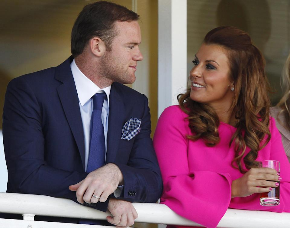 Wayne Rooney with his wife Coleen who has revealed she is pregnant with her fourth child.