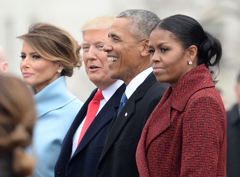 """""""I stopped even trying to smile,"""" Obama said. (Photo: Pool via Getty Images)"""