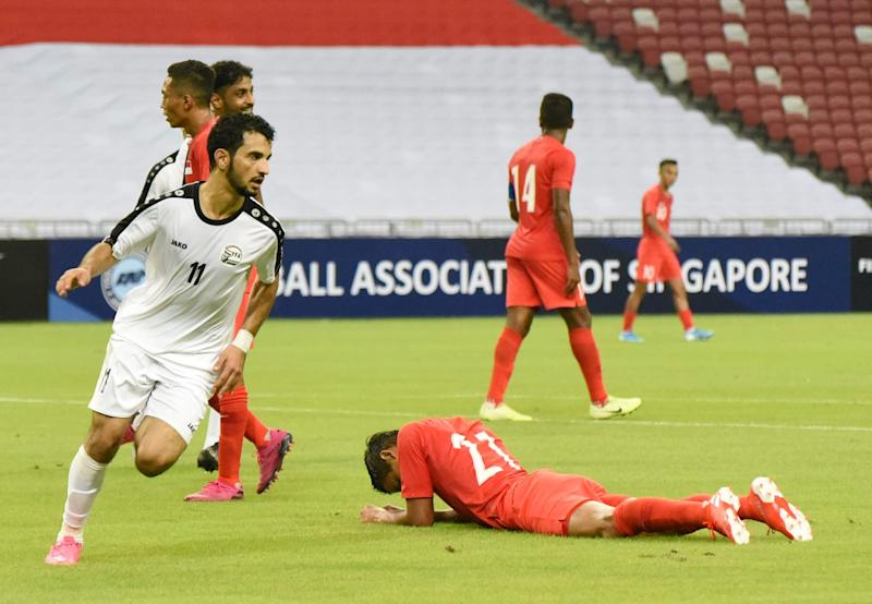 Yemen's Abdulwasea Al-Matari (left) wheels away in celebration after scoring their first goal against Singapore in their 2022 World Cup qualifying match at National Stadium. (PHOTO: Zainal Yahya/Yahoo News Singapore)