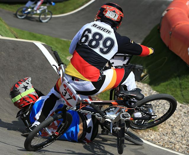 LONDON, ENGLAND - AUGUST 09: Maik Baier of Germany crashes into Tory Nyhaug of Canada during the Men's BMX Cycling Quarter Finals on Day 13 of the London 2012 Olympic Games at BMX Track on August 9, 2012 in London, England. (Photo by Phil Walter/Getty Images)