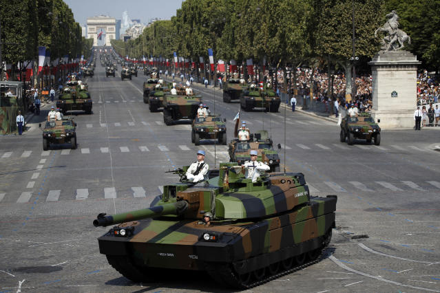 <p>Military armored vehicles drive down the Champs-Élysées during the Bastille Day parade in Paris, France, Saturday, July 14, 2018. (Photo: Francois Mori/AP) </p>