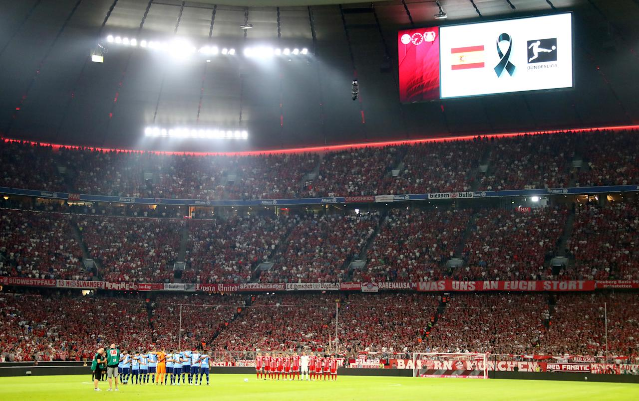 Soccer Football - Bundesliga - Bayern Munich vs Bayer Leverkusen - Munich, Germany - August 18, 2017   General view during a minute silence for the victims of the Barcelona terror attack before the match   REUTERS/Michael Dalder   DFL RULES TO LIMIT THE ONLINE USAGE DURING MATCH TIME TO 15 PICTURES PER GAME. IMAGE SEQUENCES TO SIMULATE VIDEO IS NOT ALLOWED AT ANY TIME. FOR FURTHER QUERIES PLEASE CONTACT DFL DIRECTLY AT + 49 69 650050     TPX IMAGES OF THE DAY