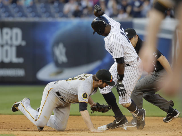 New York Yankees' Alfonso Soriano (12) slides safely into second base ahead of the tag from Pittsburgh Pirates second baseman Neil Walker on a double to left field during the eighth inning of a baseball game, Saturday, May 17, 2014, in New York. The Yankees won 7-1. (AP Photo/Julie Jacobson)
