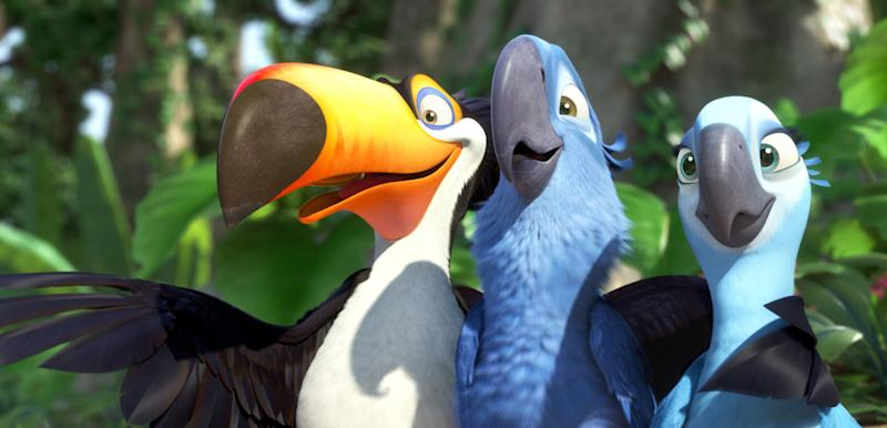 "In this publicity image released by 20th Century Fox, animated characters, from left, Raphael, voiced by George Lopez, Blu, voiced by Jesse Eisenberg, and Jewel, voiced by Anne Hathaway, are shown in a scene from ""Rio.""  The 20th Century Fox animated family flick ""Rio,"" featuring the voices of Anne Hathaway and Jesse Eisenberg, led the weekend box office with a healthy $40 million debut, according to studio estimates Sunday, April 17, 2011. (AP Photo/20th Century Fox)"