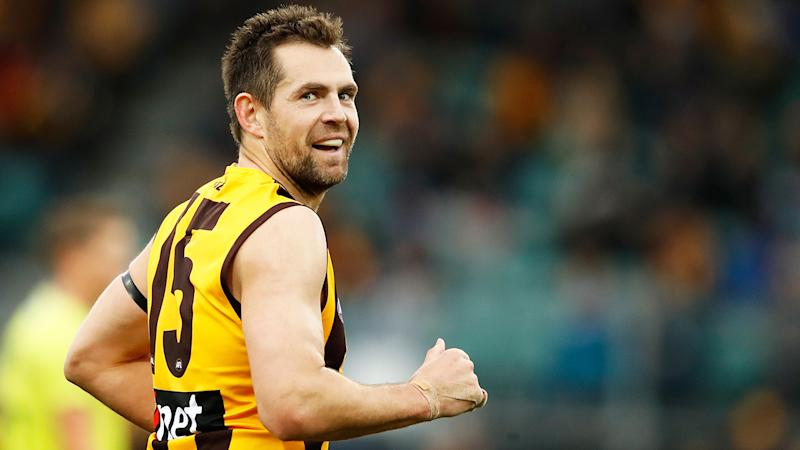 Luke Hodge is pictured playing for Hawthorn.