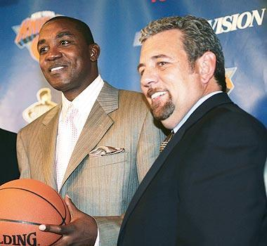 Knicks owner James Dolan (right) still speaks to Isiah Thomas regularly and tried to rehire him as a consultant until the NBA blocked the move