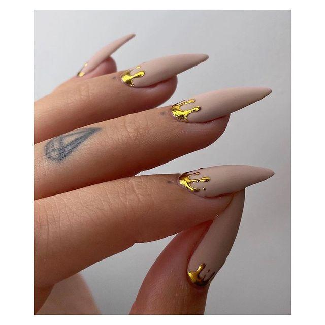 """<p>Back in 2020 silver and gold took off as an accent to fresh, natural manis. Now that it's pretty much a mani staple, artists are taking things one step further with textured dribbles using gold foil. Stun.</p><p><a href=""""https://www.instagram.com/p/CEEYQhJDnOp/"""" rel=""""nofollow noopener"""" target=""""_blank"""" data-ylk=""""slk:See the original post on Instagram"""" class=""""link rapid-noclick-resp"""">See the original post on Instagram</a></p>"""
