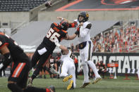 California quarterback Chase Garbers (7) throws over Oregon State outside linebacker Riley Sharp (56) during the first half of an NCAA college football game in Corvallis, Ore., Saturday, Nov. 21, 2020. (AP Photo/Amanda Loman)