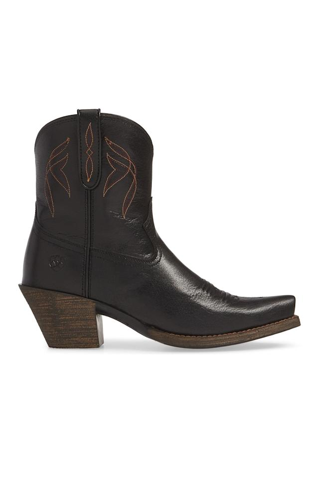 "<p><strong>Ariat</strong></p><p>nordstrom.com</p><p><strong>$159.95</strong></p><p><a href=""https://go.redirectingat.com?id=74968X1596630&url=https%3A%2F%2Fshop.nordstrom.com%2Fs%2Fariat-lovely-western-boot-women%2F5198851&sref=http%3A%2F%2Fwww.harpersbazaar.com%2Ffashion%2Ftrends%2Fg7958%2Fhow-to-wear-ankle-boots%2F"" target=""_blank"">Shop Now</a></p><p>Ariat's classic cowboy ankle boot, which comes in three color options, is the perfect way to add a little edge to all your dresses and skirts. </p>"