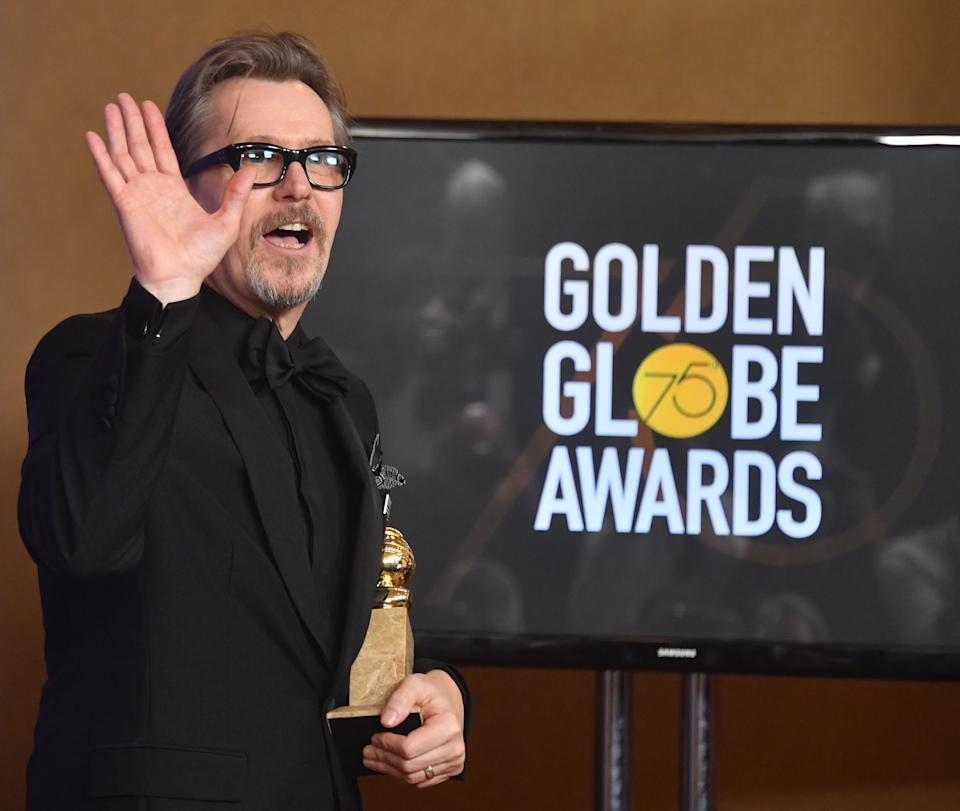 Actor Gary Oldman poses with the trophy for Best Performance by an Actor in a Motion Picture - Drama during the 75th Golden Globe Awards on January 7, 2018, in Beverly Hills, California. / AFP PHOTO / Frederic J. BROWN        (Photo credit should read FREDERIC J. BROWN/AFP via Getty Images)