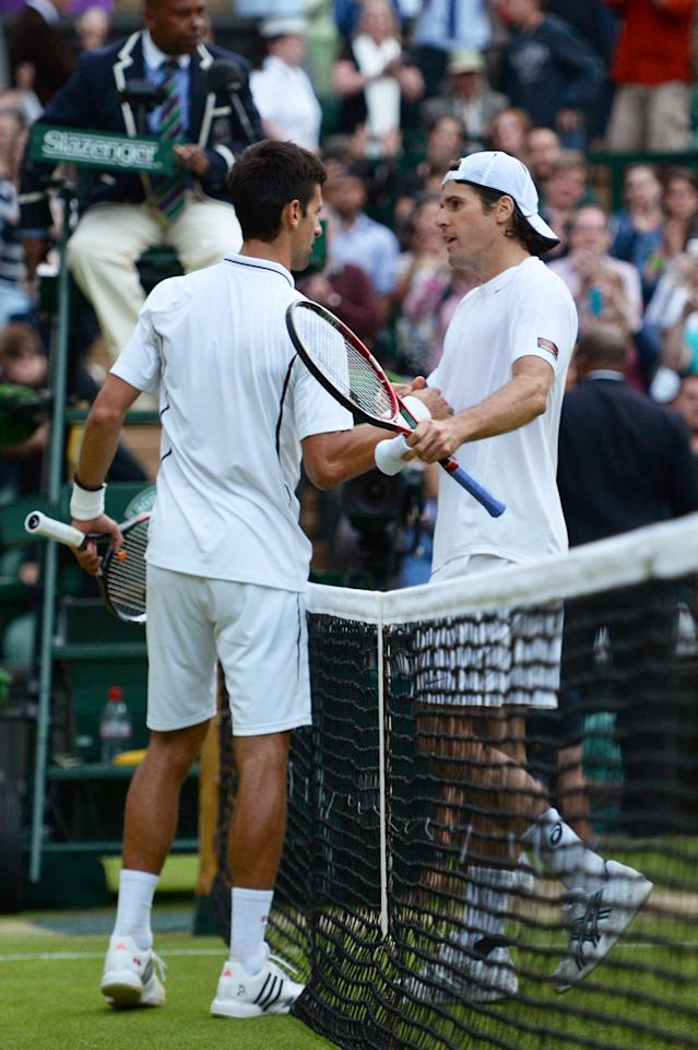 LONDON, ENGLAND - JULY 01: Novak Djokovic of Serbia shakes hands at the net with Tommy Haas of Germany after their Gentlemen's Singles fourth round match against Tommy Haas of Germany on day seven of the Wimbledon Lawn Tennis Championships at the All England Lawn Tennis and Croquet Club on July 1, 2013 in London, England. (Photo by Mike Hewitt/Getty Images)