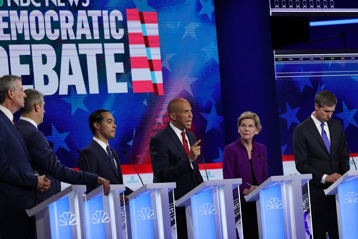 MIAMI, FLORIDA - JUNE 26: (L-R) New York City Mayor Bill De Blasio, Rep. Tim Ryan (D-OH), former housing secretary Julian Castro, Sen. Cory Booker (D-NJ) Sen. Elizabeth Warren (D-MA) and former Texas congressman Beto O'Rourke take part in the first night of the Democratic presidential debate on June 26, 2019 in Miami, Florida. A field of 20 Democratic presidential candidates was split into two groups of 10 for the first debate of the 2020 election, taking place over two nights at Knight Concert Hall of the Adrienne Arsht Center for the Performing Arts of Miami-Dade County, hosted by NBC News, MSNBC, and Telemundo. (Photo by Joe Raedle/Getty Images) ORG XMIT: 775360609 ORIG FILE ID: 1158529076