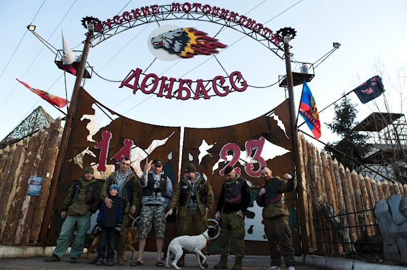 Members of the Donbass Night Wolves motorbike club pose in front of the gate of the club's base in Lugansk on March 17, 2015 (AFP Photo/John MacDougall)