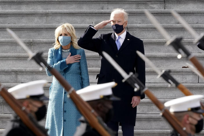 President Joe Biden and his wife Jill Biden watch a military pass in review ceremony on the East Front of the Capitol at the conclusion of the inauguration ceremonies, in Washington, Wednesday, Jan. 20, 2021. (J. Scott Applewhite/AP)