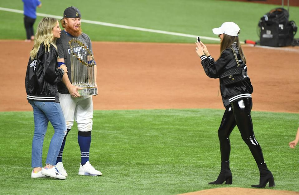 Justin Turner holds the Commissioner's Trophy next to his wife Kourtney Pogue after the Dodgers won the World Series.