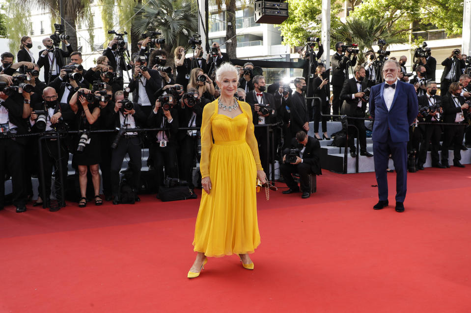 Helen Mirren, left, and Taylor Hackford pose for photographers upon arrival at the premiere of the film 'Annette' and the opening ceremony of the 74th international film festival, Cannes, southern France, Tuesday, July 6, 2021. (Photo by Vianney Le Caer/Invision/AP)