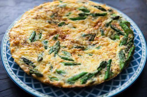 "<strong>Get the <a href=""http://www.simplyrecipes.com/recipes/asparagus_frittata/"" rel=""nofollow noopener"" target=""_blank"" data-ylk=""slk:asparagus frittata recipe"" class=""link rapid-noclick-resp"">asparagus frittata recipe</a> by Simply Recipes.</strong>"