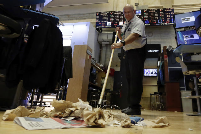 Raul Rodriguez sweeps the trading floor after the closing bell of the New York Stock Exchange. (AP Photo/Richard Drew)