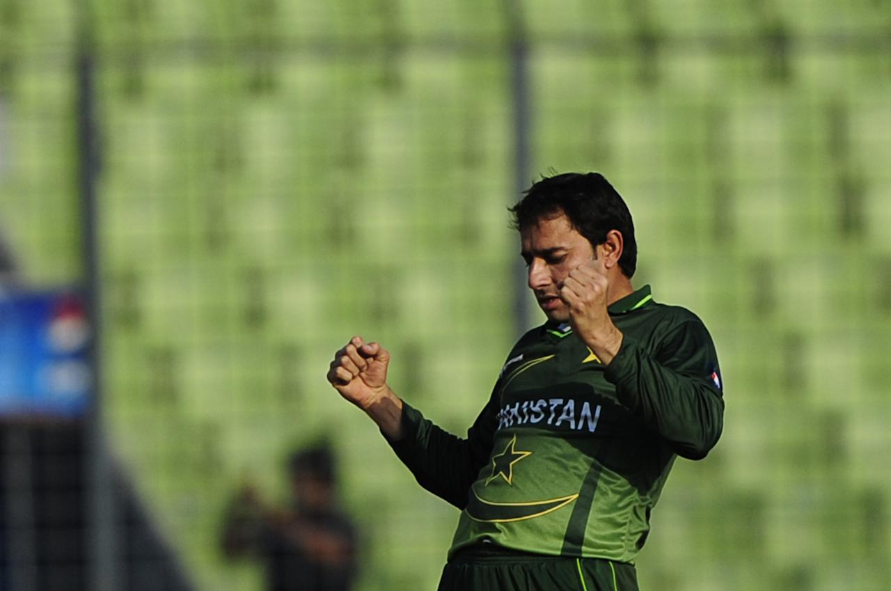 Pakistan's bowler Saeed Ajmal reacts after the dismissal of the unseen Sri Lankan batsman Farveez Maharoof during the one day international (ODI) Asia Cup cricket match between Pakistan and Sri Lanka at the Sher-e-Bangla National Cricket Stadium in Dhaka on March 15, 2012. AFP PHOTO/Munir uz ZAMAN (Photo credit should read MUNIR UZ ZAMAN/AFP/Getty Images)