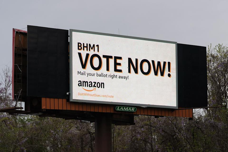 Amazon urged workers to cast their ballots as quickly as possible, before the union reached more of them. The company even had a billboard on the interstate. (Photo: Elijah Nouvelage via Getty Images)
