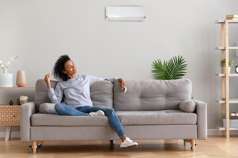 Woman relaxes on couch