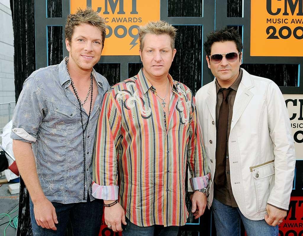 """Rascal Flatts (Joe Don Rooney, Gary LeVox, and Jay DeMarcus) sported jeans and their signature spikey 'dos. Rick Diamond/<a href=""""http://www.gettyimages.com/"""" target=""""new"""">GettyImages.com</a> - June 16, 2009"""
