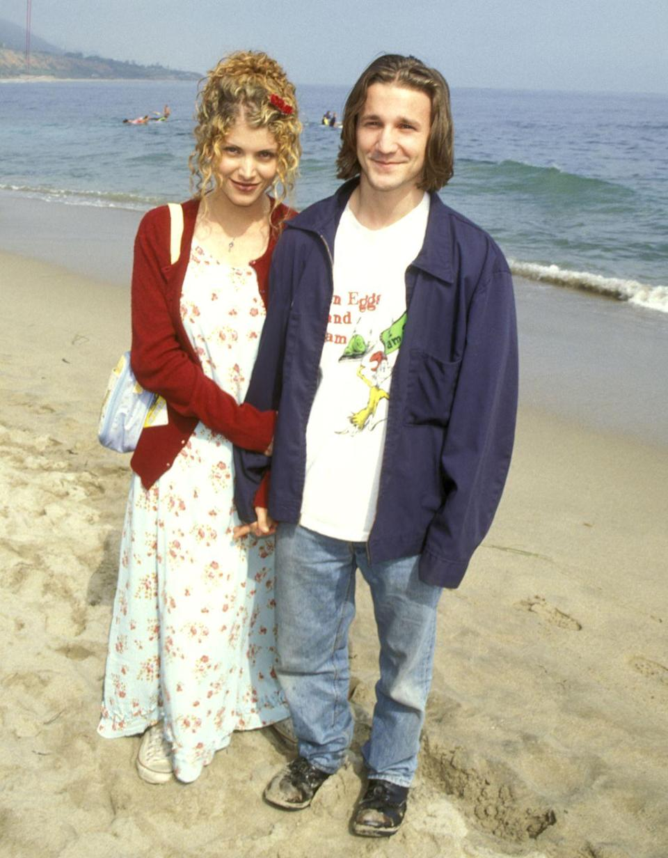 """<p>In keeping with his on-screen character Travis, Meyer opted for jeans, a """"Green Eggs and Ham"""" t-shirt, and an oversized jacket for the celebration on the beach. Here he is posing on the sand with screenwriter and director Deborah Kaplan. </p>"""