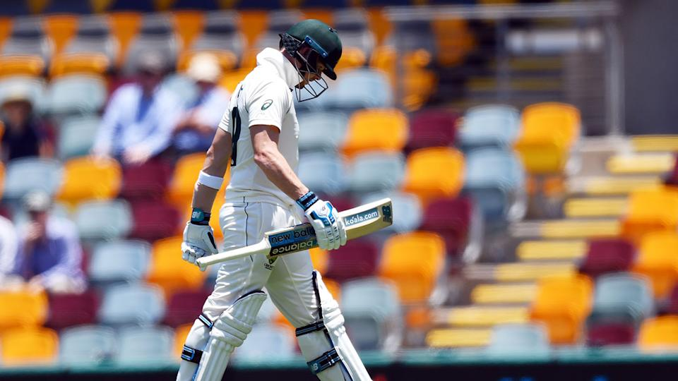 Seen here, Steve Smith walks back to the Gabba pavilion after being removed cheaply.