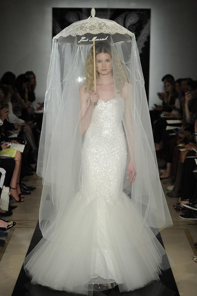 """<div class=""""caption-credit""""> Photo by: MCV Photo / The Knot</div><b>A Sparkly Number With An Umbrella Veil <br></b> While this sparkly mermaid gown by Reem Acra is attention-grabbing, it's the unique accessory that puts this one on the outrageous list. <br>"""