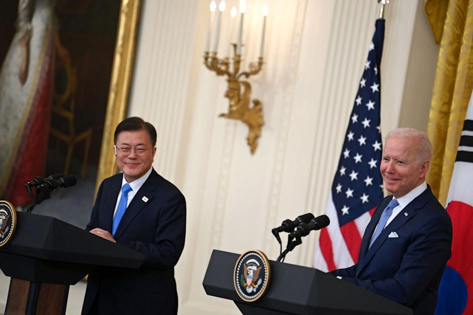US President Joe Biden (R) and South Korean President Moon Jae-in participate in a press conference in the East Room of the White House in Washington, DC on May 21, 2021. (Photo by Brendan SMIALOWSKI / AFP) (Photo by BRENDAN SMIALOWSKI/AFP via Getty Images)