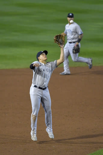 New York Yankees third baseman Gio Urshela fields a ball hit by Toronto Blue Jays' Vladimir Guerrero Jr. and forces out Teoscar Hernndez at third during the sixth inning of a baseball game in Buffalo, N.Y., Wednesday, Sept. 23, 2020. Guerrero Jr. was safe at first. (AP Photo/Adrian Kraus)