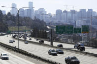 Early afternoon traffic is thin on Interstate 5 north of downtown Seattle, Friday, March 20, 2020. With many people working from home or otherwise not traveling, Seattle's notorious traffic has been minimal during the outbreak of the new coronavirus. (AP Photo/Ted S. Warren)