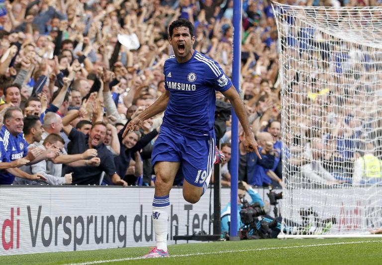 Chelsea's Brazilian-born Spanish striker Diego Costa celebrates scoring the opening goal during the English Premier League football match between Chelsea and Leicester City at Stamford Bridge in London on August 23, 2014