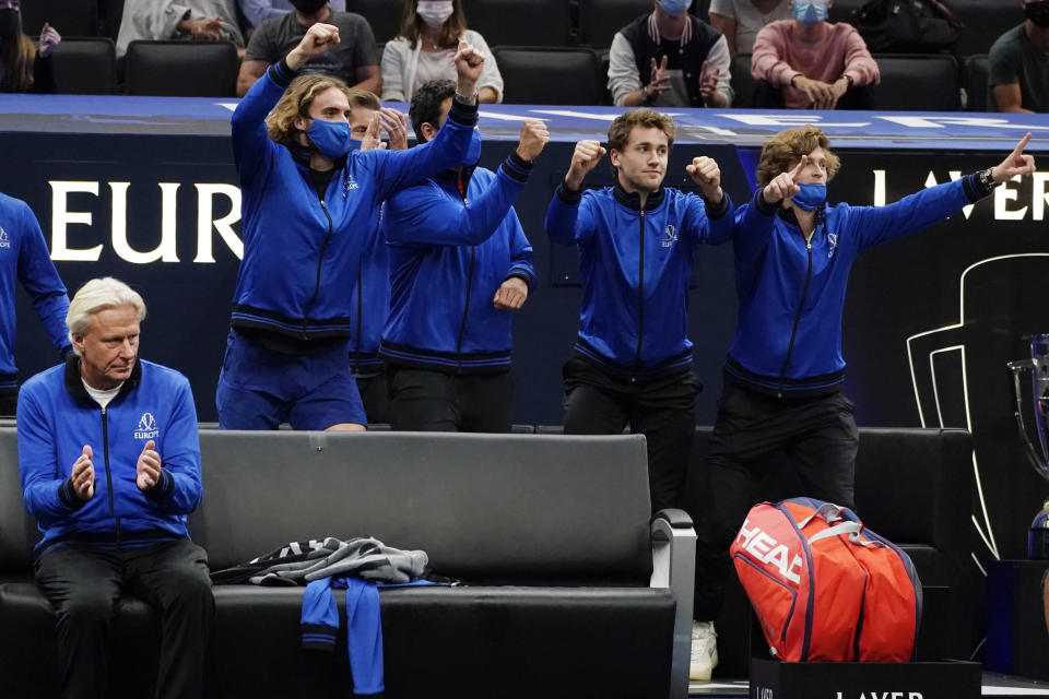 Team Europe's captain Bjorn Borg, far left, and teammates celebrate Team Europe's Alexander Zverev, of Germany, victory over Team World's John Isner, of the USA, during Laver Cup tennis, Saturday, Sept. 25, 2021, in Boston. (AP Photo/Elise Amendola)