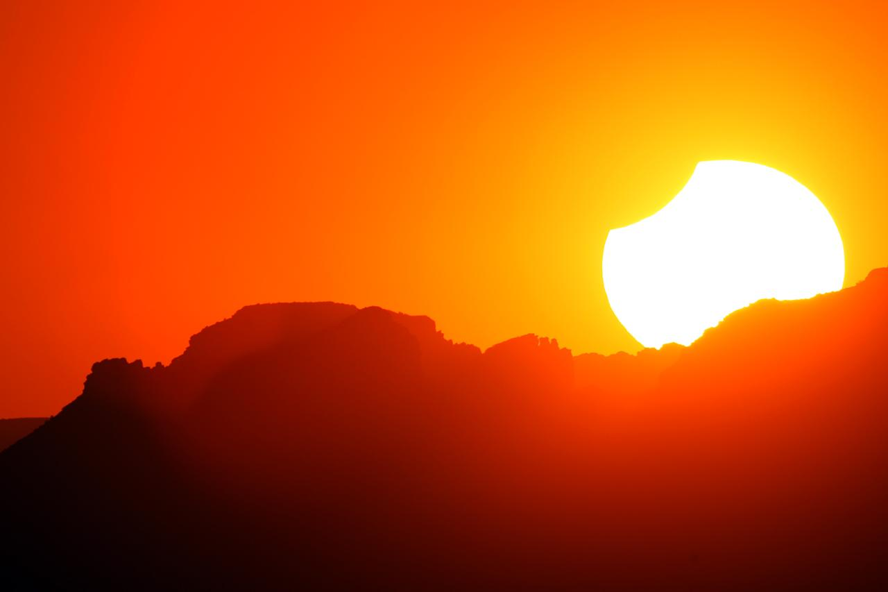 GRAND CANYON, AZ - MAY 20:  The first annular eclipse seen in the U.S. since 1994 wanes to a partial eclipse as the sun sets on May 20, 2012 in Grand Canyon National Park, Arizona. Differing from a total solar eclipse, the moon in an annular eclipse appears too small to cover the sun completely, leaving a ring of fire effect around the moon. The eclipse is casting a shallow path crossing the West from west Texas to Oregon then arcing across the northern Pacific Ocean to Tokyo, Japan.    (Photo by David McNew/Getty Images)