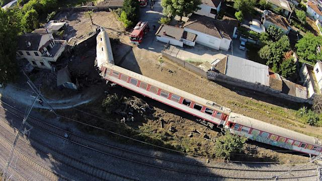 <p>A train is shown toppled on its side after derailing and crashing into a house in the town of Adendro in northern Greece, May 14, 2017. (Photo: Petros Kefalas/www.emvolos.gr via Reuters) </p>