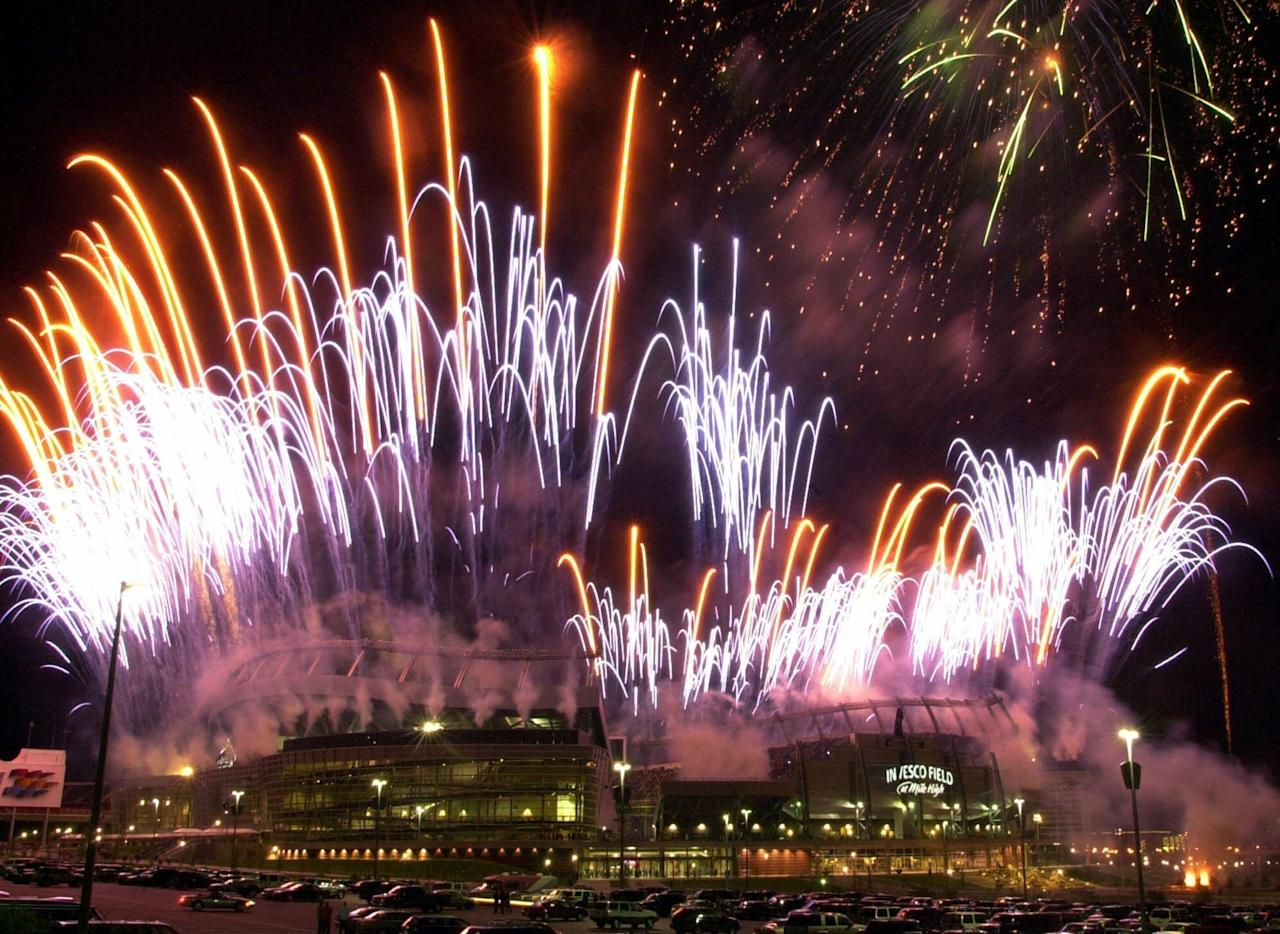 FILE - In this Aug. 11, 2001 file photo taken by Associated Press photographer Ed Andrieski, fireworks light up the sky over Invesco Field in Denver while the rock group the Eagles play during christening of the Denver Broncos new football stadium. Andrieski, a retired AP photographer who covered nearly every major news story in Colorado for more than three decades, was found dead on Tuesday, Jan. 16, 2018. He was 73. (AP Photo/Ed Andrieski, file)