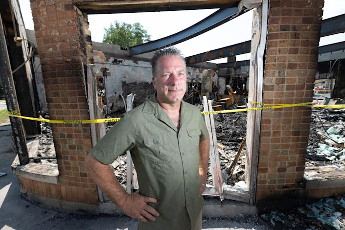 Scott Carpenter is shown with remains of his family-owned B & L Office Furniture in Kenosha. The business is insured and will rebuild.