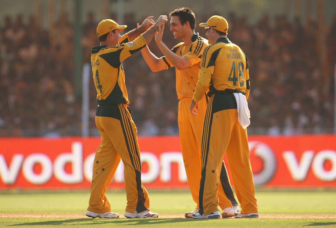VADODARA, INDIA - OCTOBER 25:  Mitchell Johnson of Australia celebrates with captain Ricky Ponting after dismissing Gautam Gambhir of India for lbw during the first One Day International match between India and Australia at Reliance Stadium on October 25, 2009 in Vadodara, India.  (Photo by Cameron Spencer/Getty Images)