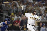 San Diego Padres' Victor Caratini (17) tosses his bat after hitting a sacrifice fly ball during the eighth inning of a baseball game against the Los Angeles Dodgers, Wednesday, June 23, 2021, in San Diego. (AP Photo/Denis Poroy)