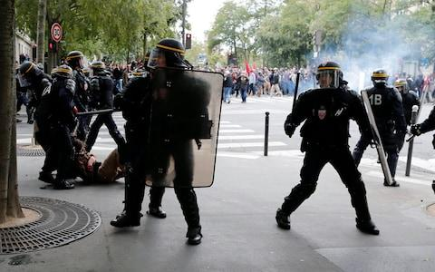 Clashes between police and protesters at demonstration against the French government's labor reforms in Paris - Credit: IAN LANGSDON/EPA