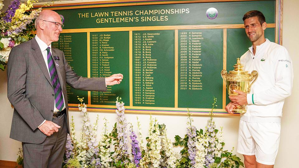 Novak Djokovic, pictured here in front of the honours board after winning Wimbledon.