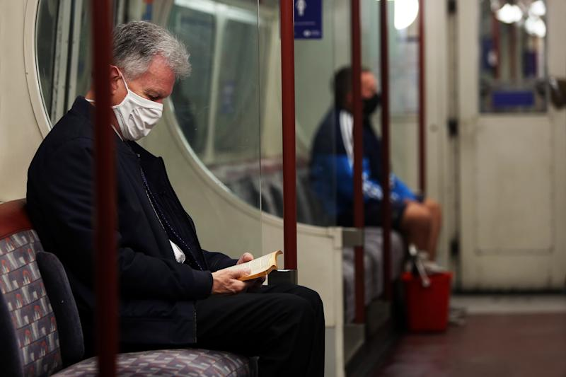 A general view of commuters wearing protective face masks on a London underground train, as the UK continues to recover from the coronavirus pandemic.