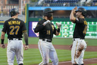 Pittsburgh Pirates' Colin Moran (19) is greeted by Bryan Reynolds (10) and Kevin Newman after hitting a three-run home run off Chicago Cubs starting pitcher Alec Mills in the first inning of a baseball game in Pittsburgh, Tuesday, Sept. 28, 2021. (AP Photo/Gene J. Puskar)