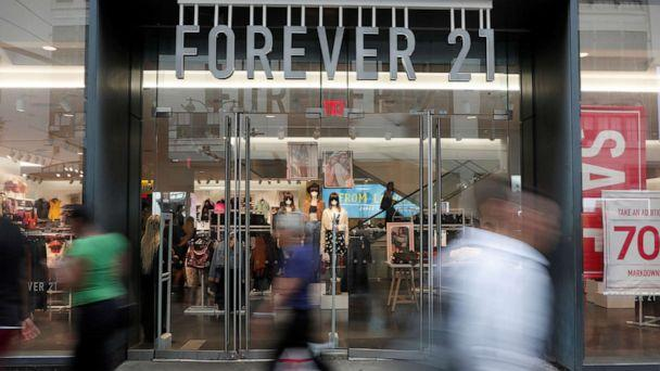 PHOTO: People walk by the clothing retailer Forever 21 in New York City, Sept. 12, 2019. (Shannon Stapleton/Reuters)