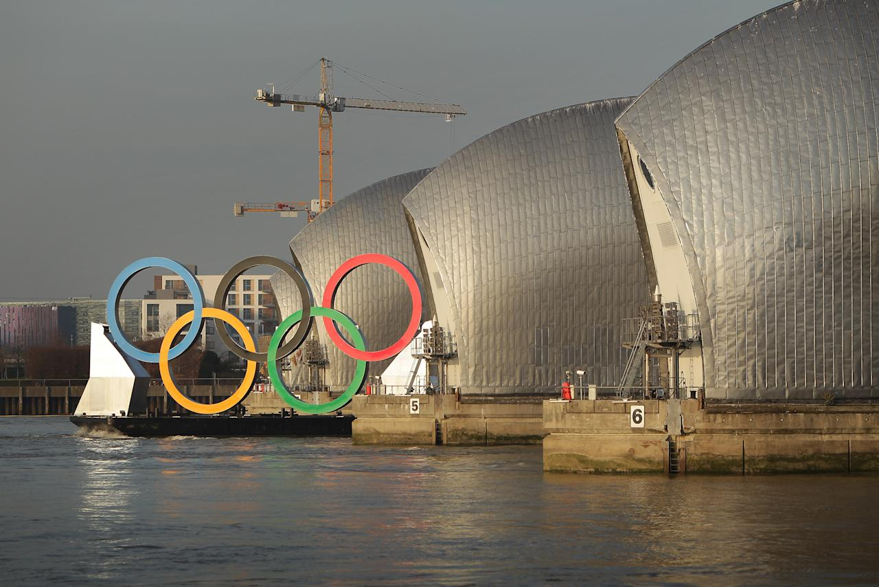 LONDON, ENGLAND - FEBRUARY 28:  Giant Olympic rings are towed through the Thames Barrier on The River Thames  on February 28, 2012 in London, England. With 150 days remaining before the start of the London 2012 games the Olympic rings, measuring 11 metres high by 25 metres wide, are being showcased on the river as Mayor of London Boris Johnson is announcing details of two new cultural programmes, which will be part of the London 2012 Festival, along with details of other cultural events being organised to celebrate the London 2012 Olympic and Paralympic Games.  (Photo by Peter Macdiarmid/Getty Images)
