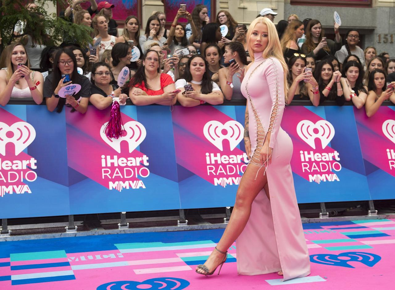 <p>The singer worked her signature curves in a risqué pale pink gown with lace-up detail that literally ran from head to toe. </p>